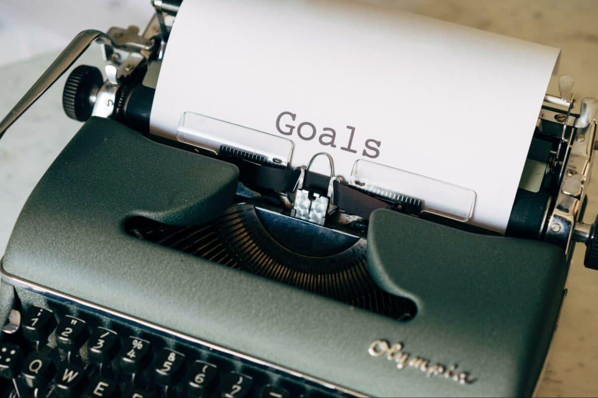 word GOALS on sheet at typewriter
