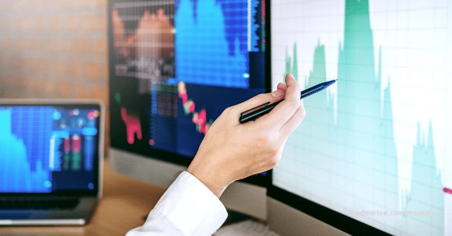 man analyzing chart on the screen